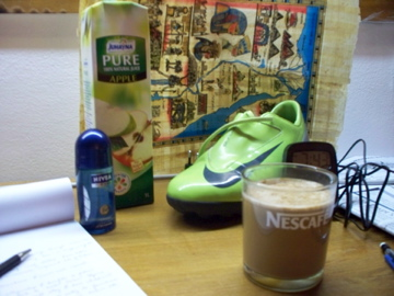 This is a picture of 3 in 1 coffee. Also featured is one of my new ultimate shoes (they're sweeet!), the strange deoderant dispensers here, apple juice and a sideways papyrus map of Egypt.